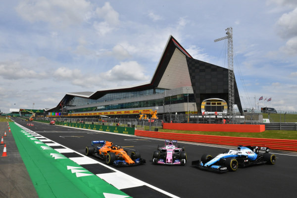 McLaren MCL34, Racing Point RP19 and Williams Racing FW42 in front of the Silverstone Wing