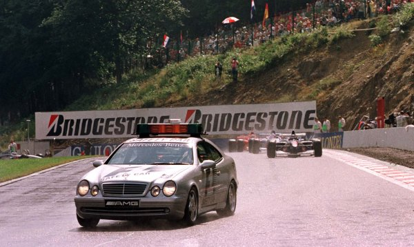 1997 Belgian Grand Prix.Spa-Francorchamps, Belgium.22-24 August 1997.The safety car leads the field for three laps before a rolling start. The race had been delayed due to a thunderstorm.World Copyright - Tee/LAT Photographic
