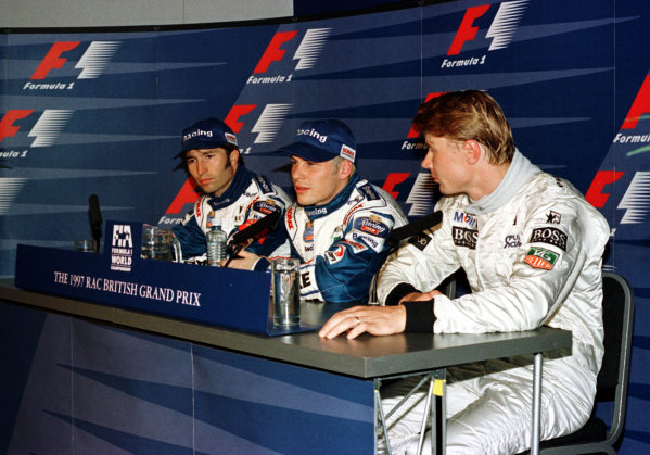 1997 British Grand Prix.Silverstone, England.11-13 July 1997.Jacques Villeneuve (Williams Renault) faces the press after qualifying on pole position. Heinz-Harald Frentzen (Williams Renault) and Mika Hakkinen (McLaren Mercedes-Benz) will be 2nd and 3rd on the grid.World Copyright - LAT Photographic