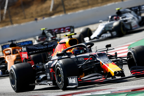 Alexander Albon, Red Bull Racing RB16, leads Carlos Sainz, McLaren MCL35, Kevin Magnussen, Haas VF-20, and Pierre Gasly, AlphaTauri AT01