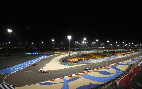 Lance Stroll, Aston Martin AMR21, leads Carlos Sainz, Ferrari SF21