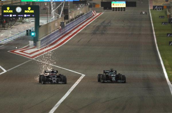 Sparks fly as Yuki Tsunoda, AlphaTauri AT02, battles with Lance Stroll, Aston Martin AMR21