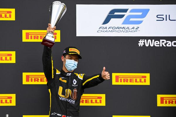 Guanyu Zhou (CHN, UNI-VIRTUOSI) celebrates on the podium with the trophy