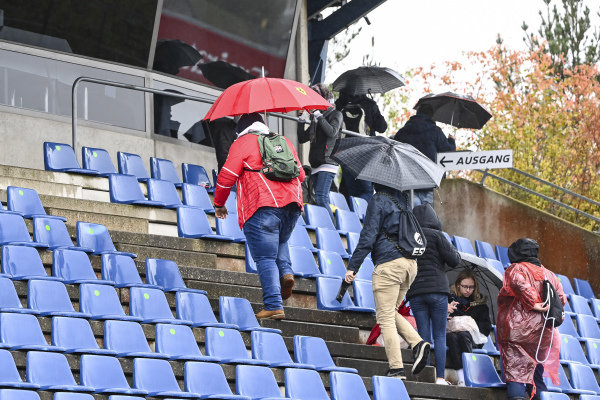 Fans in the grandstand during the rain