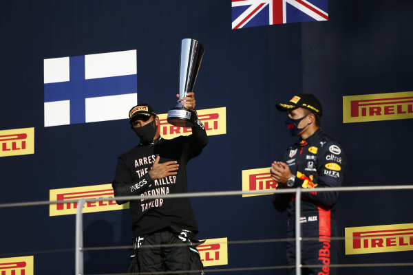 Lewis Hamilton, Mercedes-AMG Petronas F1, 1st position, with his trophy, and Alexander Albon, Red Bull Racing, 3rd position, on the podium