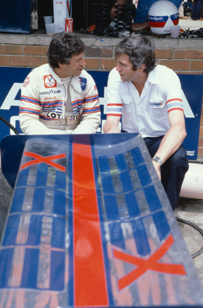1980 South African Grand Prix.Kyalami, South Africa.28/2-1/3 1980.Mario Andretti (Lotus Ford) with a team colleague.Ref-80 SA 20.World Copyright - LAT Photographic