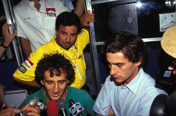 Alain Prost and Ayrton Senna speak to the media.