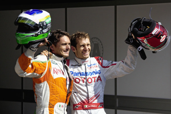 A surprise front row: pole sitter Giancarlo Fisichella with fellow Italian Jarno Trulli in parc ferme.