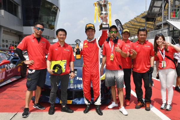 Nobuhiro Imada, Rosso Scuderia, celebrates third place in parc ferme