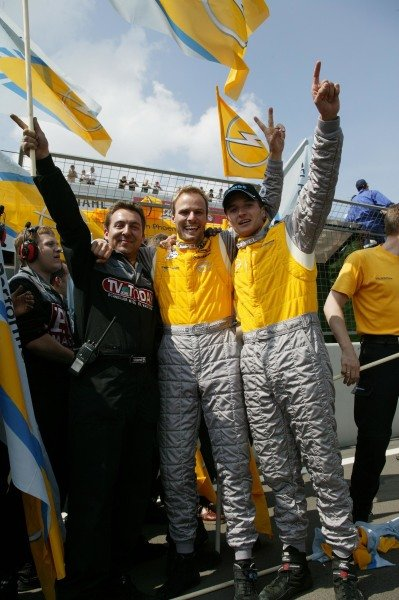 Marcel Tiemann (GER) and Timo Schider (GER) celebrate with Opel mechanics after their race win.