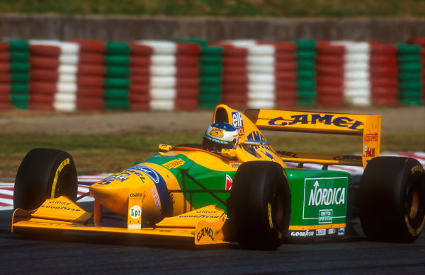 1993 Japanese Grand Prix.Suzuka, Japan.22-24 October 1993.Michael Schumacher (Benetton B193B Ford). He exited the race after his steering was damaged due to a brush with Hill early on.Ref-93 JAP 16.World Copyright - LAT Photographic