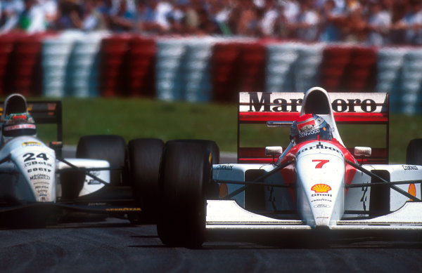 1993 Canadian Grand Prix.Montreal, Quebec, Canada.11-13 June 1993.Michael Andretti (McLaren MP4/8 Ford) 14th position followed by Fabrizio Barbazza (Minardi M193 Ford).Ref-93 CAN 08.World Copyright - LAT Photographic