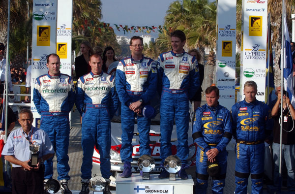 World Rally Championship,  Cyprus Rally, April 18-21, 2002. 'Olympic' Podium for the top 3 finishers: 1st, Gronholm; 2nd, Burns; 3rd, Makinen  Photo: Ralph Hardwick/LAT