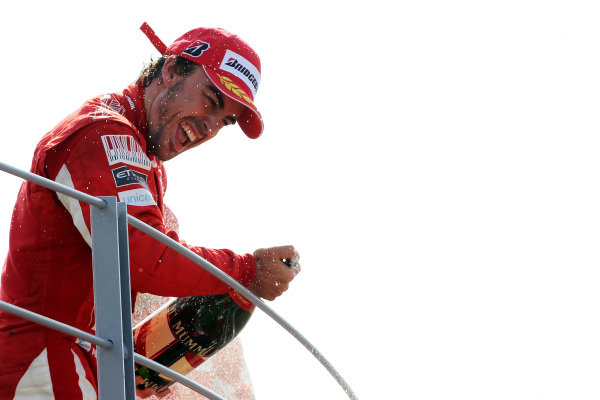 Race winner Fernando Alonso (ESP) Ferrari celebrates on the podium.