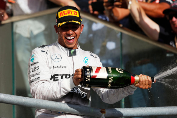 Circuit of the Americas, Austin, Texas, United States of America. Sunday 2 November 2014. Lewis Hamilton, Mercedes AMG, 1st Position, sprays Champagne on the podium. World Copyright: Steven Tee/LAT Photographic. ref: Digital Image _L4R9882