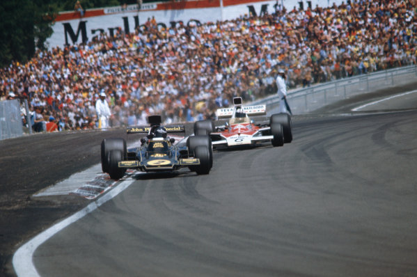 1974 French Grand Prix  Dijon-Prenois, France. 5-7th July 1974.  Jacky Ickx, Lotus 72E Ford, 5th position, leads Denny Hulme, McLaren M23 Ford, 6th position.  Ref: 74FRA05. World Copyright: LAT Photographic