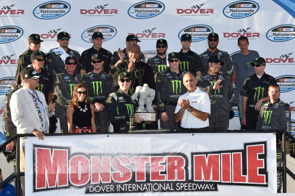25-27 September, 2014, Dover, Delaware USA Kyle Busch, Monster Energy Toyota Camry celebrates the win in victory lane with team and crew ?2014, Scott R LePage  LAT Photo USA