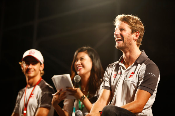 Suzuka Circuit, Japan. Saturday 08 October 2016. Romain Grosjean, Haas F1, and Esteban Gutierrez, Haas F1, at a fan event. World Copyright: Andy Hone/LAT Photographic ref: Digital Image _ONY5346