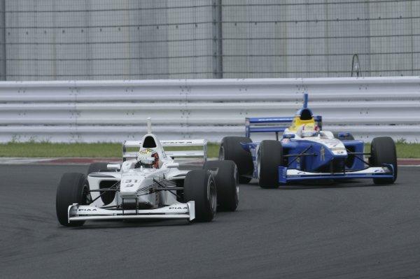 2005 Formula Nippon Championship.Round 7, Fuji Speedway, Japan. 28th August 2005Race winner Andre Lotterer (PIAA Nakajima) 1st leads Tatsuya Kataoka (Forum Engineering) 2nd. Action.World Copyright: Yasushi Ishihara / LAT Photographicref: Digital Image Only