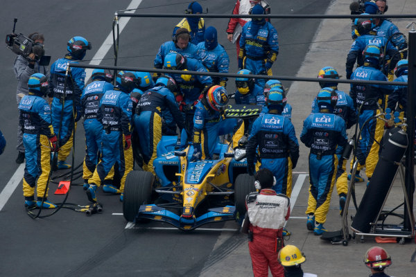 2005 Canadian Grand Prix - Sunday Race,Montreal, Canada. 12th June 2005Fernando Alonso, Renault R25 climbs out of his damaged car in the pits World Copyright: Steven Tee/LAT Photographicref: 48mb HiRes Digital Image