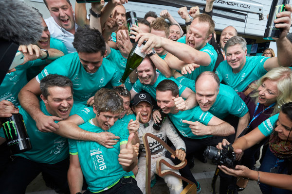 Red Bull Ring, Spielberg, Austria. Sunday 21 June 2015. Nico Rosberg, Mercedes AMG, 1st Position, celebrates with his team. World Copyright: Steve Etherington/LAT Photographic. ref: Digital Image SNE25035