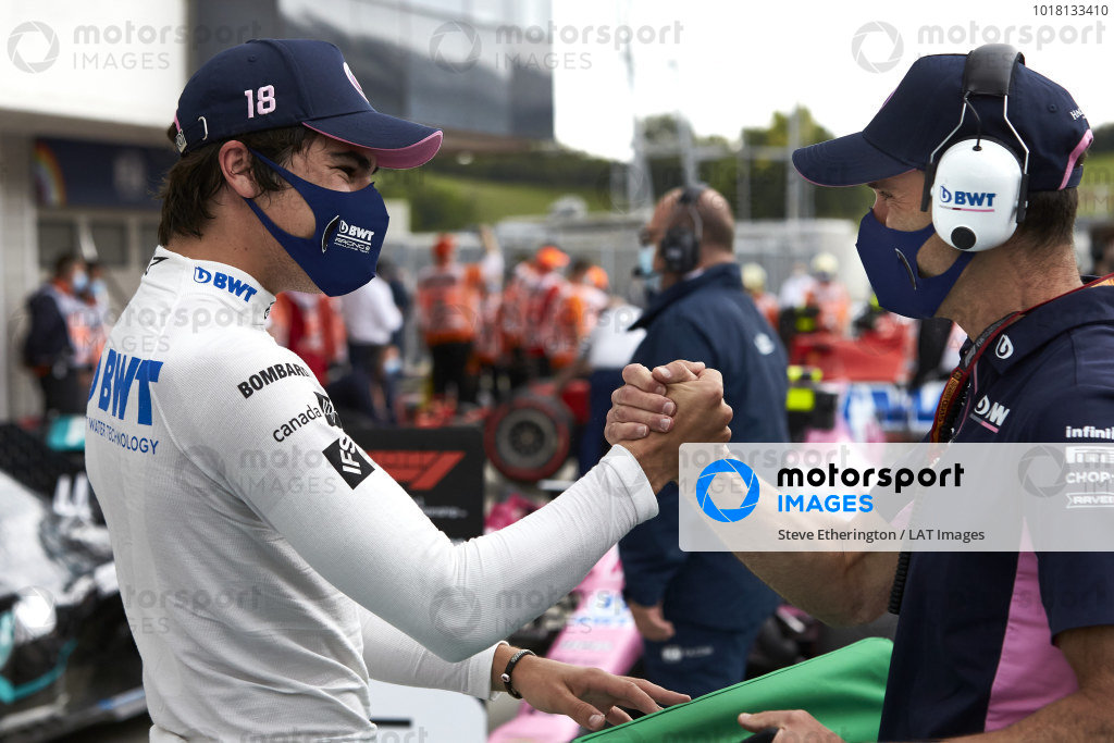 Lance Stroll, Racing Point, is congratulated by a team member in parc ferme