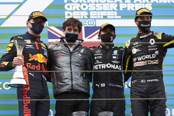 Max Verstappen, Red Bull Racing, 2nd position, Steven Lord, Mercedes, Lewis Hamilton, Mercedes-AMG Petronas F1, 1st position, and Daniel Ricciardo, Renault F1, 3rd position, on the podium