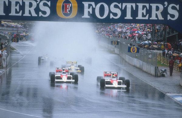 1989 Australian Grand Prix.Adelaide, Australia.3-5 November 1989.Ayrton Senna leads teammate Alain Prost (both McLaren MP4/5 Honda's) with Pierluigi Martini (Minardi M189 Ford) behind in the spray at the start.Ref-89 AUS 36.