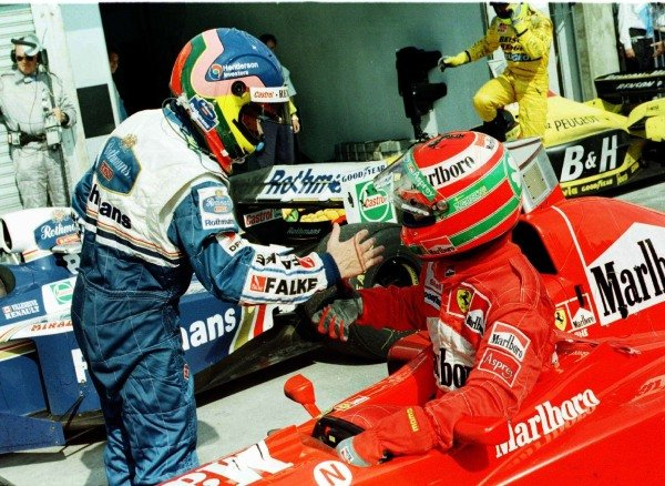 1997 Argentinian Grand Prix.Buenos Aires, Argentina.11-13 April 1997.Jacques Villeneuve (Williams FW19 Renault) and Eddie Irvine (Ferrari F310B) after finishing in 1st and 2nd positions respectively.World Copyright - LAT Photographic