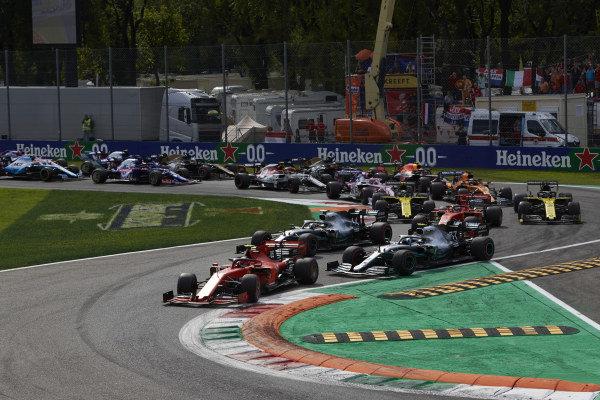 Charles Leclerc, Ferrari SF90, leads Valtteri Bottas, Mercedes AMG W10, Lewis Hamilton, Mercedes AMG F1 W10, Sebastian Vettel, Ferrari SF90, and the rest of the field at the start