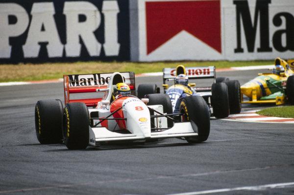 Ayrton Senna, McLaren MP4-8 Ford, leads Alain Prost, Williams FW15C Renault, and Michael Schumacher, Benetton B193A Ford.