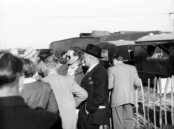 1949 British Grand Prix.Silverstone, Great Britain. 14 May 1949.Louis Chiron, Emmanuel de Graffenried and Earl Howe talk in the paddock.Ref-B/W Print.World Copyright - LAT Photographic
