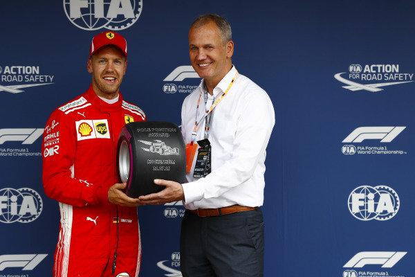 Sebastian Vettel, Ferrari, receives the Pirelli pole position award.