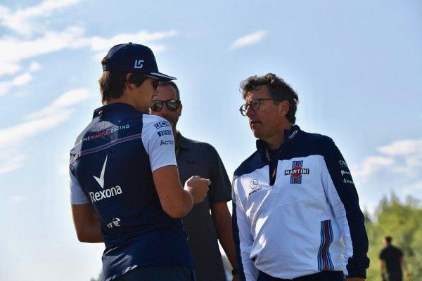 Lance Stroll (CDN) Williams walks the track with Luca Baldisserri (ITA) Williams Race Engineer