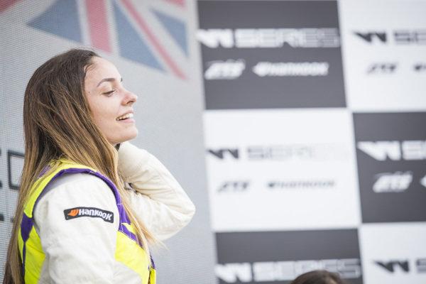 Marta Garcia (ESP) celebrates on the podium after winning the race
