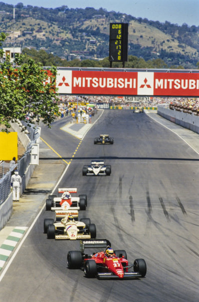 Michele Alboreto, Ferrari 156/85, leads Gerhard Berger, Arrows A8 BMW, Alain Prost, McLaren MP4-2B TAG, Marc Surer, Brabham BT54 BMW, and Elio de Angelis, Lotus 97T Renault.