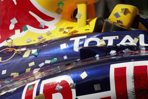 Confetti on the side of a Red Bull RB7 Renault.