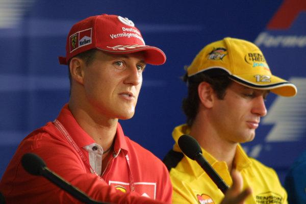 2001 Brazilian Grand Prix.Interlagos, Sao Paulo, Brazil. 30/3-1/4 2001.Michael Schumacher (Ferrari) and Jarno Trulli (Jordan Honda) at a press conference.World Copyright - Rose/LAT Photographicref: 8 9 MB Digital