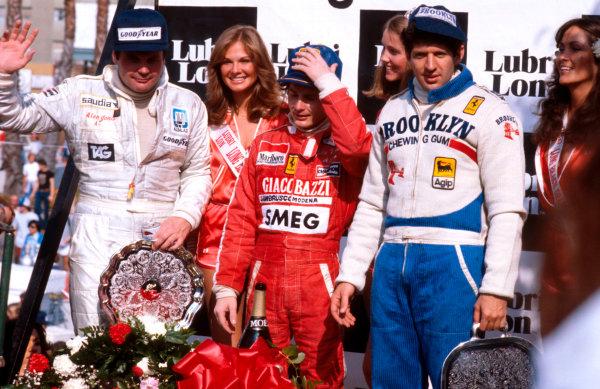 1979 United States Grand Prix West.Long Beach, California, USA.6-8 April 1979.Gilles Villeneuve (Ferrari) 1st position, Jody Scheckter (Ferrari) 2nd position and Alan Jones (Williams Ford) 3rd position on the podium.Ref-79 LB 05.World Copyright - LAT Photographic