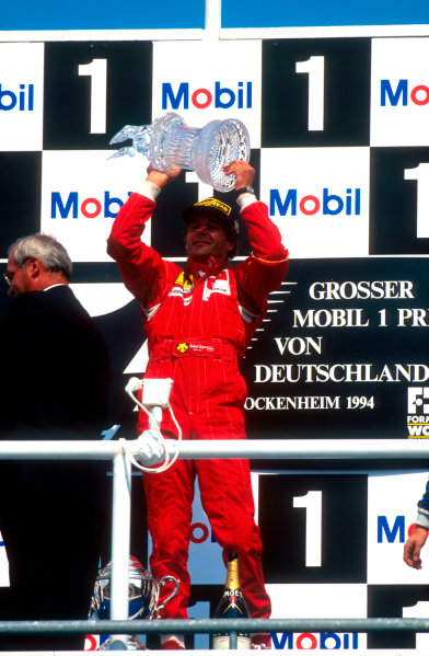 1994 German Grand Prix.Hockenheim, Germany.29-31 July 1994.Gerhard Berger (Ferrari) celebrates 1st position on the podium.  World Copyright - LAT Photographic