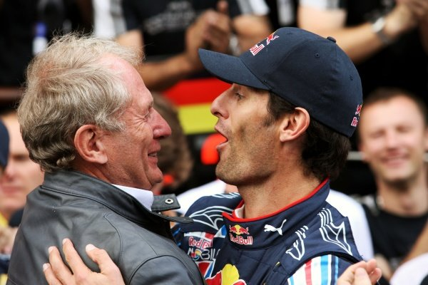 Mark Webber (AUS) Red Bull Racing celebrates his first GP win with Dr Helmut Marko (AUT) Red Bull Motorsport Consultant and the team.