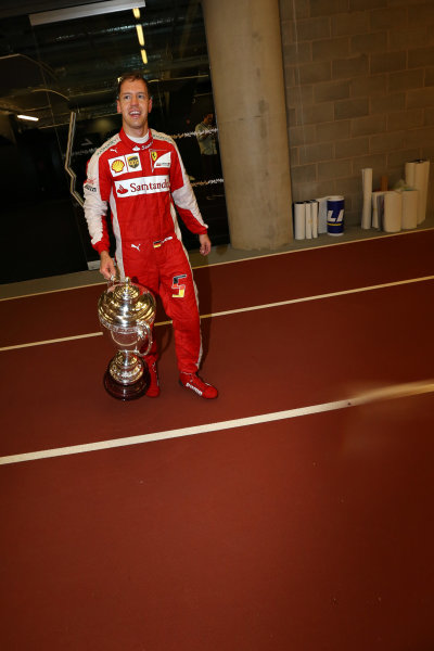 2015 Race Of Champions Olympic Stadium, London, UK Saturday 21 November 2015 Sebastian Vettel (GER) with his trophy on the running track Copyright Free FOR EDITORIAL USE ONLY. Mandatory Credit: 'IMP'