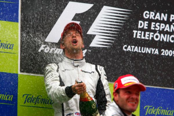 Circuit de Catalunya, Barcelona, Spain10th May 2009Winner Jenson Button, Brawn GP BGP001 Mercedes celebrates on the podium with champagne.World Copyright: Charles Coates/LAT Photographicref: Digital Image _26Y8659