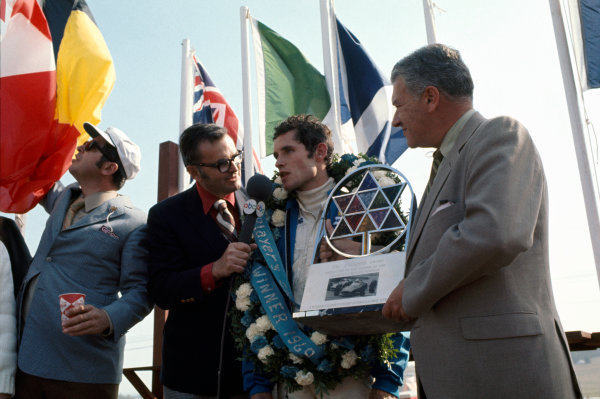 Mosport Park, Ontario, Canada.18-20 September 1969.Jacky Ickx (Brabham/MRD) 1st position, on the podium, portrait.World Copyright: LAT Photographic.Ref: Colour Transparency.