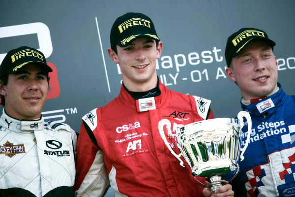 Round 6.Hungaroring, Budapest, Hungary. 1st August 2010. Sunday Race.Alexander Rossi (USA, ART Grand Prix) celebrates victory on the podium with Robert Wickens, (CAN, Status Grand Prix) and Dean Smith, (GBR, Carlin). Portrait. World Copyright: Drew Gibson/GP3 Media Service. Digital Image _Y8P5012