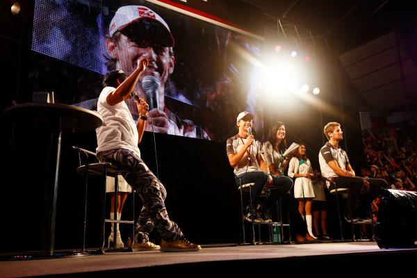 Suzuka Circuit, Japan. Saturday 08 October 2016. Esteban Gutierrez, Haas F1, and Romain Grosjean, Haas F1., at a fan event. World Copyright: Andy Hone/LAT Photographic ref: Digital Image _ONZ4791