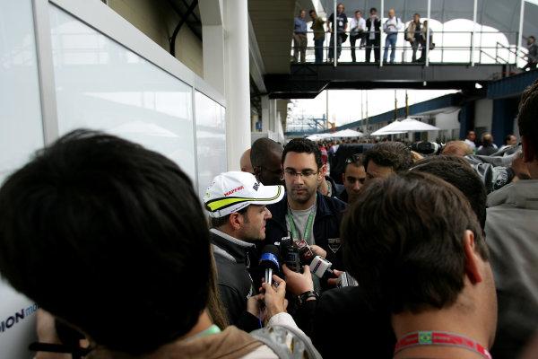 Interlagos, Sao Paulo, Brazil.16th October 2009.Rubens Barrichello, Brawn GP BGP001 Mercedes talks to the media in the paddock. Portrait.World Copyright: Charles Coates/LAT Photographicref: Digital Image ZK5Y4964