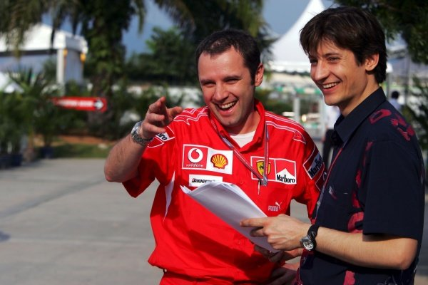 (L to R): Stefano Domenicali (ITA) Ferrari Manager of F1 Operations talks with Massimo Rivola (ITA) Scuderia Toro Rosso Team Manager.