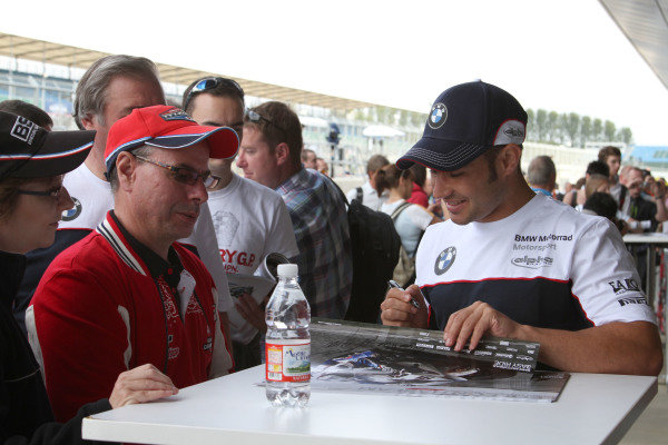 Silverstone, England. 29th-31st July 2011. Leon Haslam, BMW, signs an autograph for a fan. Portrait. Atmosphere. World Copyright: Kevin Wood/LAT Photographic. ref: Digital Image IMG_4801a