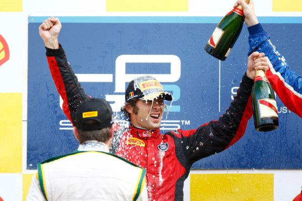 Spa - Francorchamps, Spa, Belgium. 28th August. Sunday Race. Luca Filippi (ITA, Scuderia Coloni) celebrates his victory on the podium. Photo: Glenn Dunbar/GP2 Media Service. Ref: _G7C7814 jpg